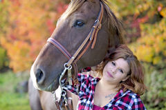 Beautiful and natural adult woman outdoors with horse Royalty Free Stock Images