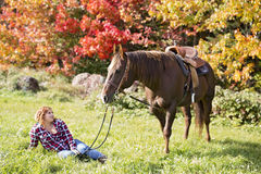 Beautiful and natural adult woman outdoors with horse Stock Photography