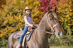 Beautiful and natural adult woman outdoors with horse Stock Images