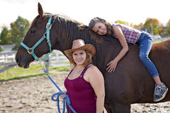 Beautiful and natural adult woman outdoors with horse  child Stock Photos