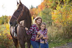 Adult woman outdoors with horse and child Stock Images
