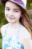 Beautiful natural beauty little girl schoolgirl student wears in a dress, bright sunny summer day outdoors fresh air Royalty Free Stock Images