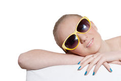 Beautiful natural blond young girl with sunglasses. Headshot of beautiful natural blond young girl with sunglasses & blue manicure nails isolated stock photo