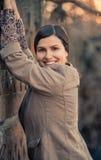 Beautiful natural brunette woman smiling Stock Image
