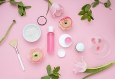 Natural cosmetic pink flat lay with flowers. Top view. Beautiful Natural cosmetic pink flat lay with fresh tulips. Top view Stock Photo