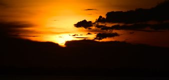 Dark Sky After the Sunset Photograph. A beautiful natural dark cloudy sky captured after the sunset time Stock Images