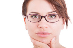 Beautiful and natural face of a woman wearing eyeglasses Stock Images