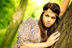 Beautiful natural gir. L lying on the tree outdoors royalty free stock image