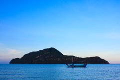 Beautiful natural landscape sea and mountain. With fishing boat Royalty Free Stock Photo