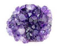 Beautiful natural purple amethyst geode crystals gemstone. Isolated on white Stock Image