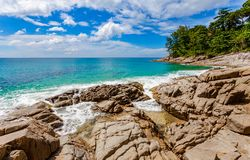 Beautiful natural rock above Naithon beach. Naithon Beach is a quiet beach holiday at a mostly natural sandy beach with a relaxed stock images