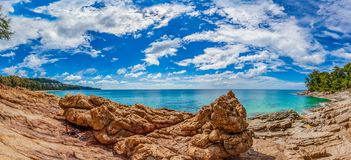 Beautiful natural rock above Naithon beach. Naithon Beach is a quiet beach holiday at a mostly natural sandy beach with a relaxed royalty free stock photography