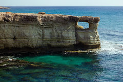 Beautiful natural rock arch near of Ayia Napa, Cavo Greco on Cyprus island Royalty Free Stock Photography