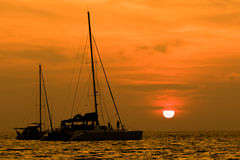 Beautiful natural scenic of sun set behind sailing boat Royalty Free Stock Photos