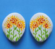 Natural stones with painted flowers Stock Photography