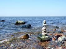 Beautiful natural stones tower on Baltic sea coast, Lithuania. Beautiful natural stones tower on baltic sea, can use as background stock photos