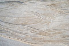 Sand pattern on the beach. Beautiful natural texture design left by the tide on the beach royalty free stock photography
