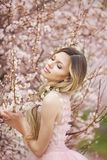 Beautiful natural woman in the garden of flowers royalty free stock photos