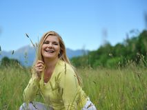 Beautiful natural woman outdoors in a field Stock Photography
