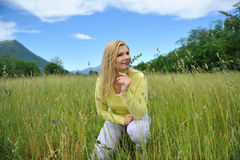 Beautiful natural woman outdoors on a field Royalty Free Stock Photo