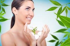 Beautiful natural woman, spa concept, green plant Royalty Free Stock Image