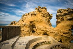 Beautiful natural yellow rock formation on atlantic coast in blue sky, biarritz, basque country Royalty Free Stock Photo