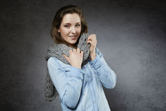 Beautiful natural young woman with soft scarf Royalty Free Stock Image