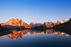 Beautiful nature background, mountain landscape at sunset, panoramic view of Alps. With reflection in lake stock photos