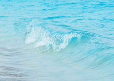 Blue wave on a beach Royalty Free Stock Photo