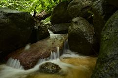 Beautiful in nature, cascading tropical river wet and mossy rock royalty free stock image