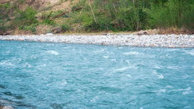 Beautiful nature. The course of a mountain river. Clean Mountain River With a Strong Current Flows Rapidly From the Mountains of t stock footage
