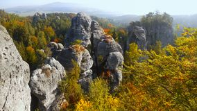 Beautiful Nature Geopark, Bohemian Paradise, Bizarre Rock Town. High bizarre sandstone rocks and forest in colorful autumnal landscape. Bohemian Paradise - a stock images