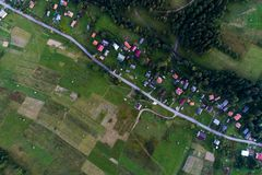 Aerial view of the village in the Carpathian mountains. Beautiful nature landscape aerial view of the village in the Carpathian mountains. Top view. From above Royalty Free Stock Photo