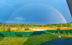 Beautiful nature landscape with double full rainbow above field panorama royalty free stock photo