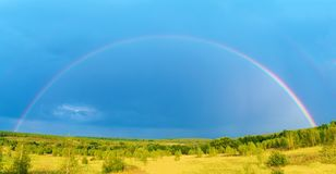 Beautiful nature landscape with double full rainbow above field panorama stock images