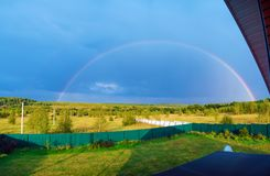 Beautiful nature landscape with double full rainbow above field panorama stock photo