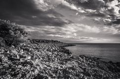 Beautiful nature and landscape photo in black and white of incoming storm at Adriatic Sea in Croatia. Beautiful nature and landscape photo in black and white of Stock Images