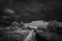 Beautiful nature and landscape photo in black and white of incoming storm in Croatia. Dark cloudy sky and bad weather. Dramatic and abstract image with high Royalty Free Stock Images
