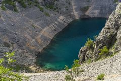 Beautiful nature and landscape photo of Blue Lake Imotski Croatia. Blue Lake Imotski Croatia, Beautiful nature and landscape photo of very big, deep sinkhole in royalty free stock photos