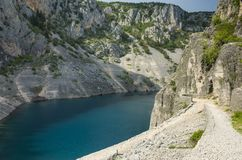 Beautiful nature and landscape photo of Blue Lake Imotski Croatia. Blue Lake Imotski Croatia, Beautiful nature and landscape photo of very big, deep sinkhole in stock photo