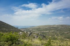 Beautiful nature and landscape photo of Dalmatia in Croatia Europe. Nice sunny spring day with blue sky and mountains at horizon. Calm, peaceful, joyful and stock images