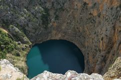 Beautiful nature and landscape photo of Red Lake Imotski Croatia. Blue Lake Imotski Croatia, Beautiful nature and landscape photo of very big, deep sinkhole in royalty free stock images