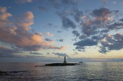Beautiful nature and landscape photo of small lighthouse at Adriatic Sea in Croatia. Nice blue colorful sunset evening. Lovely sky and ocean. Calm, peaceful stock images