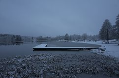 Beautiful nature and landscape photo of snowy blue dusk evening and wooden bridge in Katrineholm Sweden Scandinavia. Beautiful nature and landscape photo of stock photos