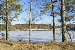 Beautiful nature and landscape photo of sunny spring day in Sweden at ice lake. Beautiful nature and landscape photo of sunny spring day in Sweden Scandinavia royalty free stock image
