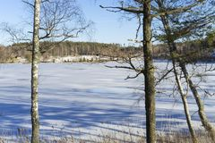 Beautiful nature and landscape photo of sunny spring day in Sweden at ice lake. Beautiful nature and landscape photo of sunny spring day in Sweden Scandinavia royalty free stock images