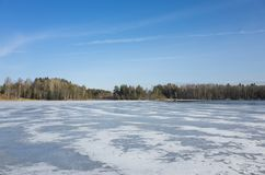 Beautiful nature and landscape photo of sunny spring day in Sweden Scandinavia Europe. Nice blue sky and lake with ice. Calm, peaceful and happy outdoor photo royalty free stock photography