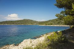 Beautiful nature and landscape photo of sunny summer day at Adriatic Sea in Dalmatia, Croatia, Europe. Nice outdoors at Mediterranean coast. Calm, peaceful and Royalty Free Stock Photo