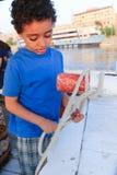 Egyptian boy on boat royalty free stock photo