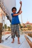 Egyptian boy on boat royalty free stock image
